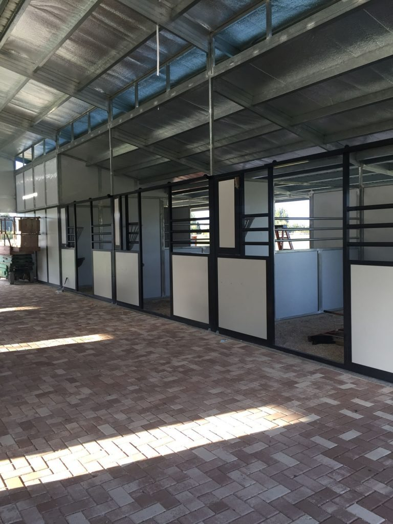 10 stall RCA Ranchers Series Barn - Interior Breezeway of RCA Barn with Open Horse Stalls