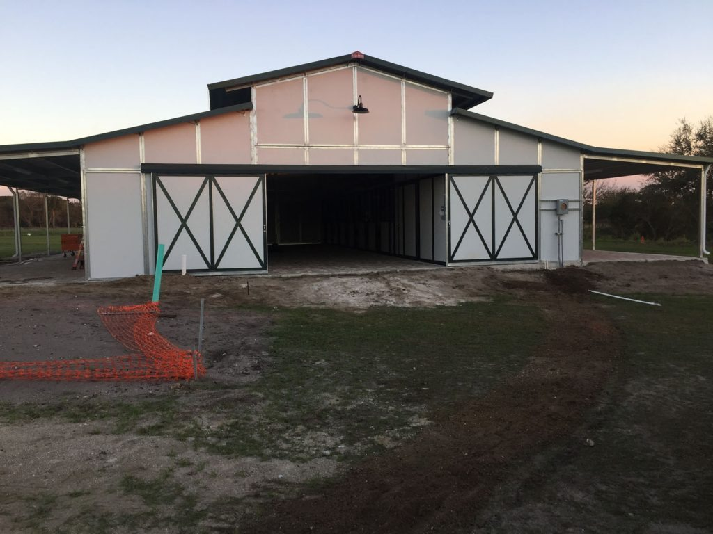 10 stall RCA Ranchers Series Barn - RCA Barn with Open Sliding Breezeway Doors and Dual Overhangs