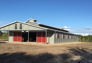 Raised Center Aisle (RCA) Barns - Raised-Center-Aisle Barn with Sliding Breezeway Doors